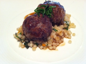 Moroccan-spiced lamb crepenette, cous cous and moroccan demi-glace